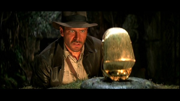 Indiana Jones hesitates to take the idol, unsure whether the Incas forged it during the steroid era.